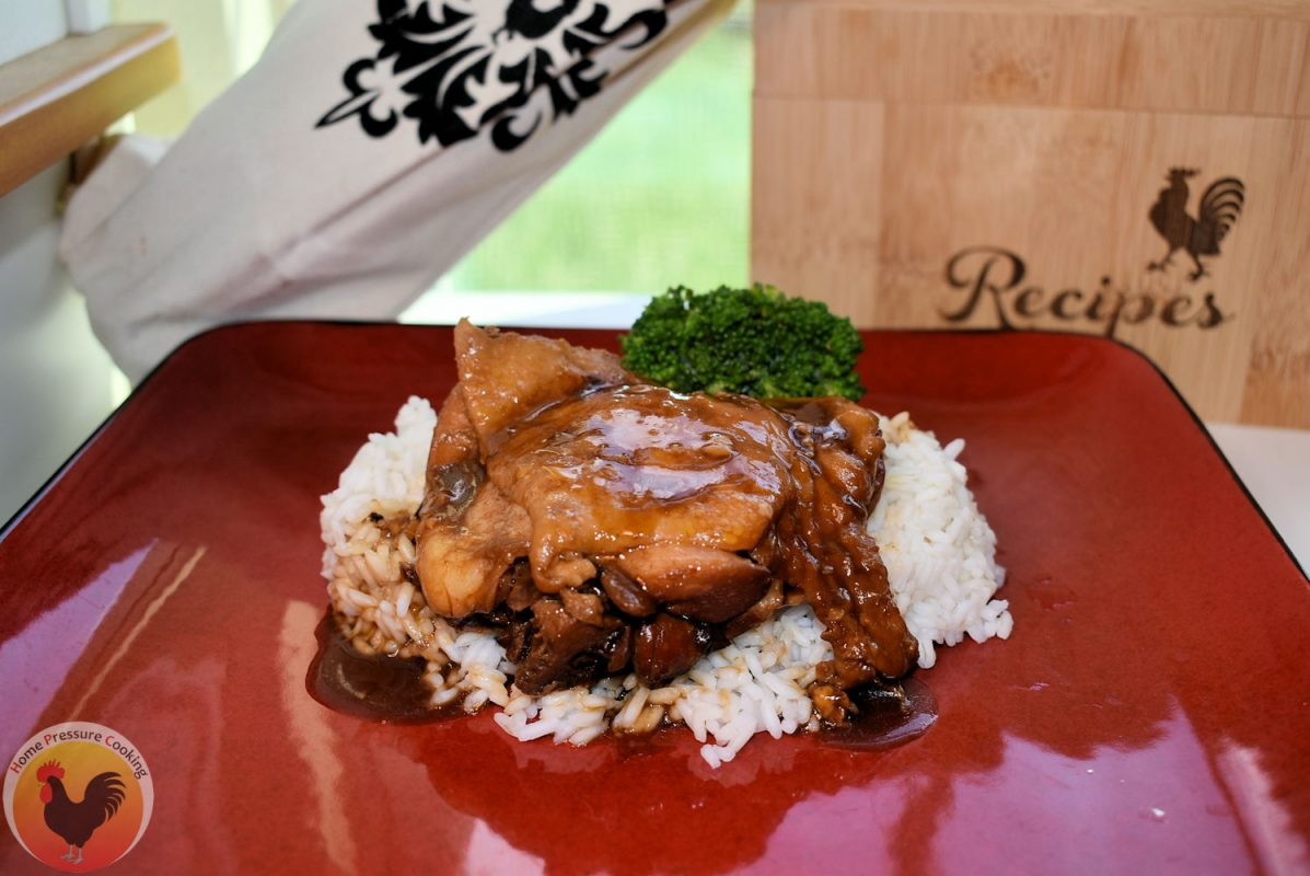 Freshly made hoisin chicken resting on a bed of white rice.