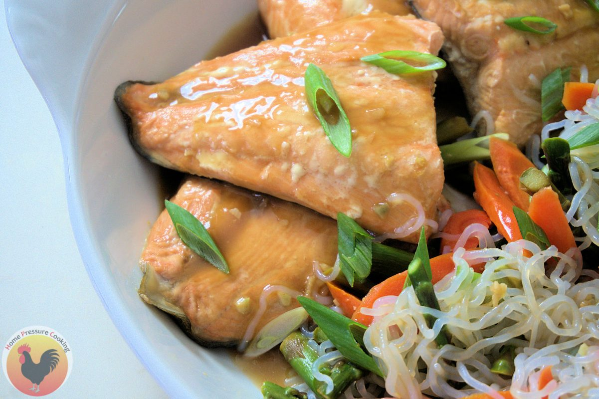 Salmon steaks with green onions and teriyaki sauce and noodles