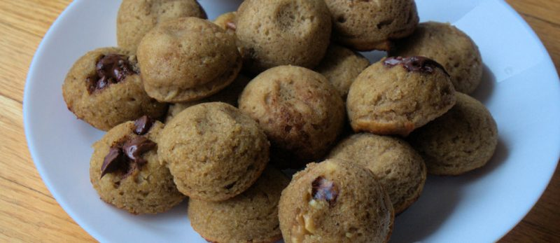 a close up of banana bread bites on a plate. Some with walnuts and some with chocolate chips.
