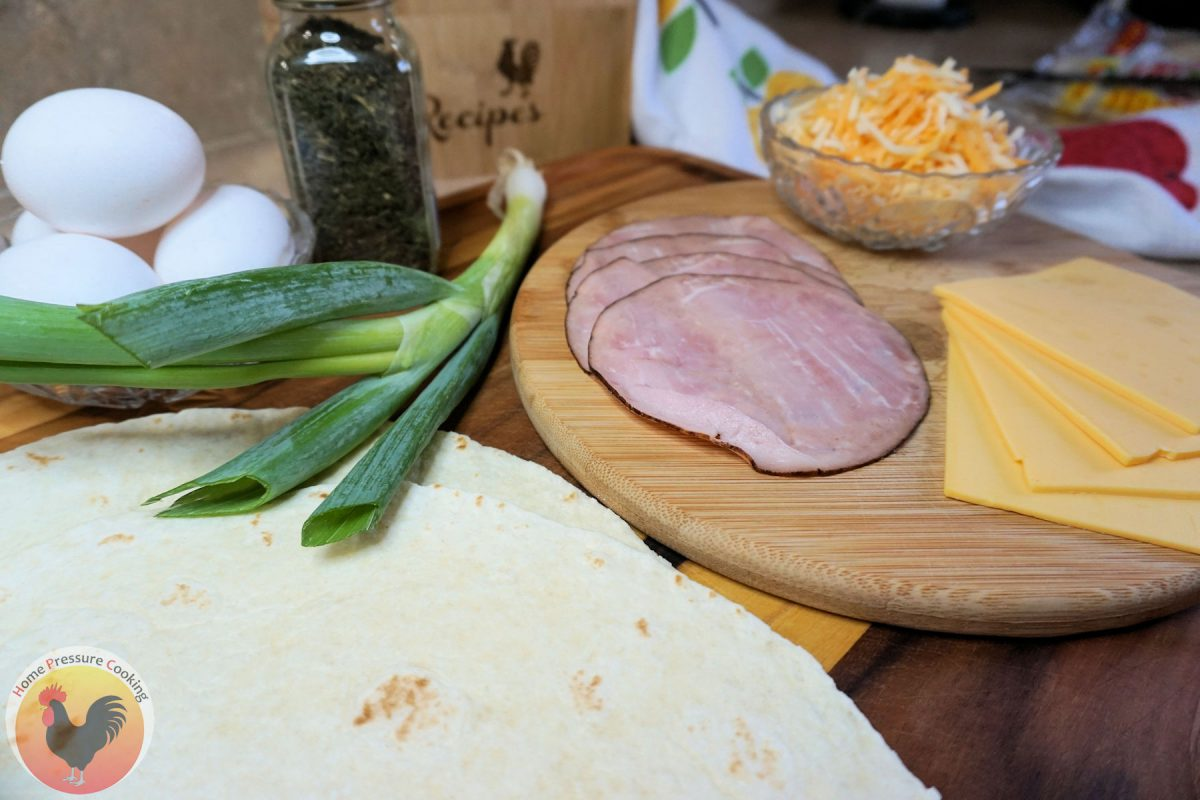 the ingredients for a basic ham and cheese breakfast crunchwrap