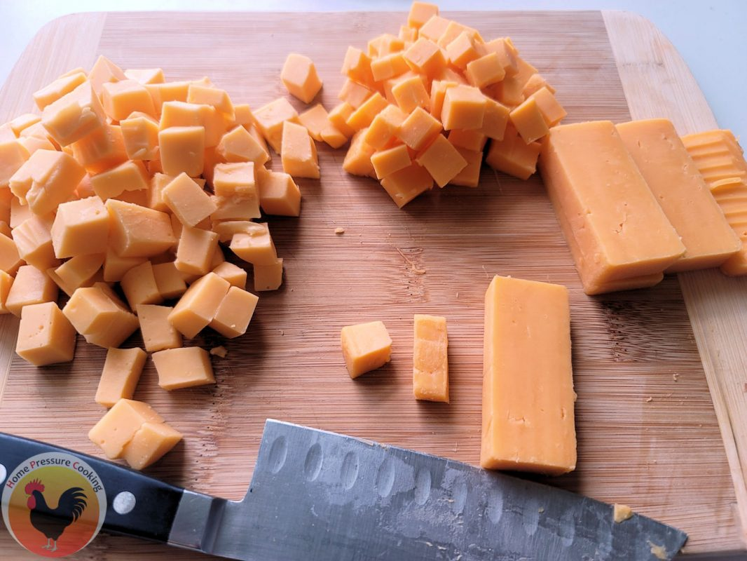 a photo showing the two blocks of cheese cut into small squares.